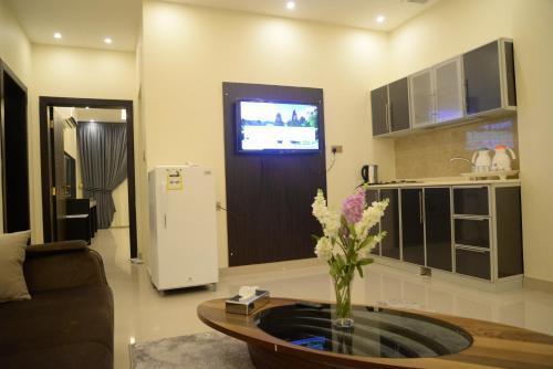 A cozinha ou cozinha compacta de Gardenia Furnished Units