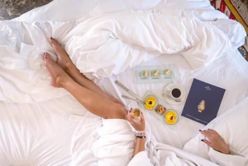 Ein Bett oder Betten in einem Zimmer der Unterkunft The Oberoi Beach Resort, Sahl Hasheesh