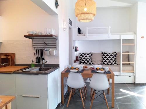 A cozinha ou kitchenette de Pedras D'el Rei Waterfront Loft