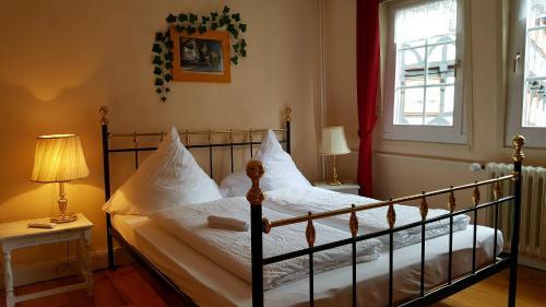 Ein Bett oder Betten in einem Zimmer der Unterkunft B&B Märchenhaftes