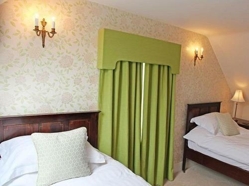 A bed or beds in a room at The Lion
