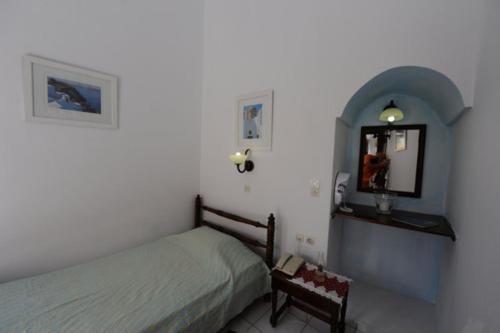 Ένα ή περισσότερα κρεβάτια σε δωμάτιο στο Kavalari Hotel