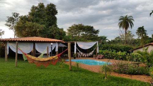 The swimming pool at or near Pousada Estância das Angolas