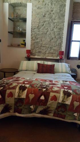 A bed or beds in a room at La Torretta - Cerreto Grue