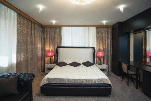 Кровать или кровати в номере Гостиница Буржуй