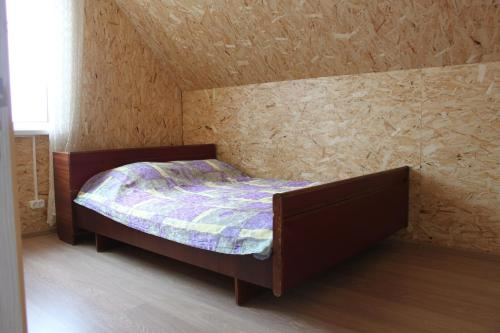 A bed or beds in a room at Sibirsky Style