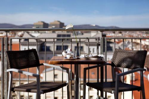 A balcony or terrace at Flemings Selection Hotel Wien-City