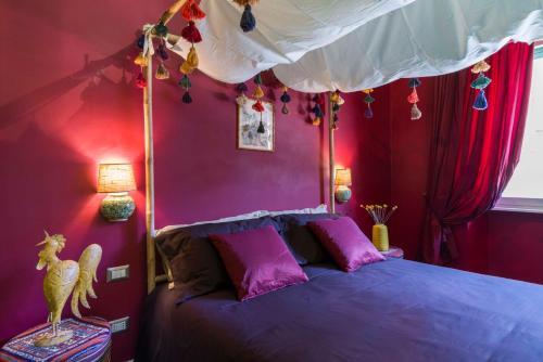Letto o letti in una camera di Frími Boutique Rooms b&b