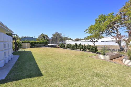 A garden outside 12th Tee BnB and Villas