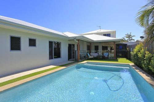 The swimming pool at or near 12th Tee BnB and Villas