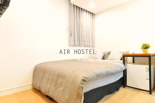 A bed or beds in a room at Air Hostel Myeongdong
