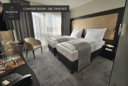 Postel nebo postele na pokoji v ubytování PREMIUM Wellness & Wine Hotel Znojmo