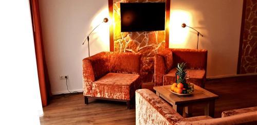 Ein Sitzbereich in der Unterkunft Hotel Restaurant Dolores