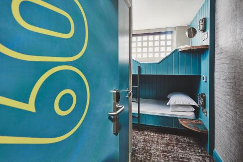 A bunk bed or bunk beds in a room at The Garrison