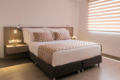 Cama o camas de una habitación en Hotel Lomas 10
