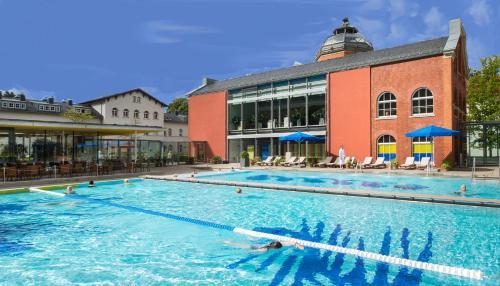 The swimming pool at or near Hotel König Albert