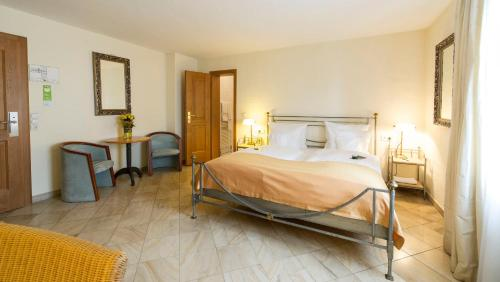 A bed or beds in a room at Lindner Hotel & Spa Binshof