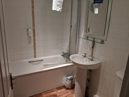 A bathroom at White Hart, Andover by Marston's Inns