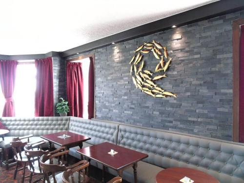 A restaurant or other place to eat at Merkister Hotel