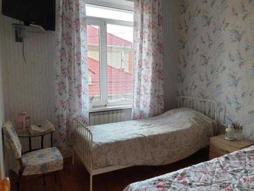 Кровать или кровати в номере Гостевой дом у Моря