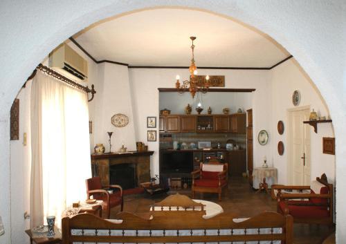 A seating area at Athena Cretan Traditional Maisonette