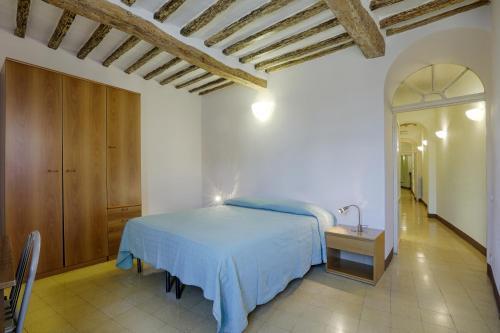 Cama ou camas em um quarto em Attilio Camere