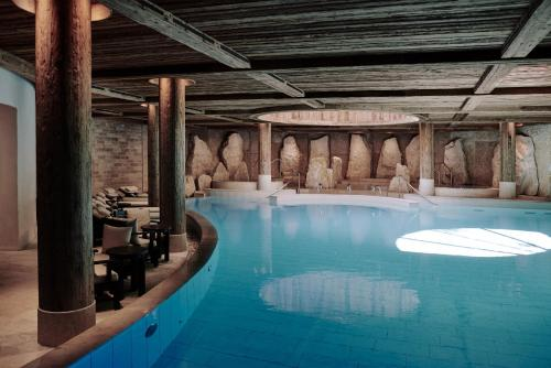 The swimming pool at or near The Alpina Gstaad