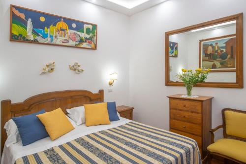 A bed or beds in a room at Villa Briganti Seaview Exclusive Terrace