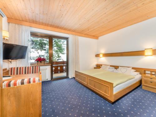 Letto o letti in una camera di Hotel Pontives