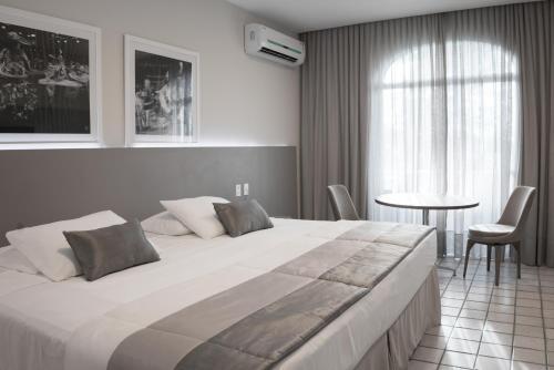 Cama ou camas em um quarto em Blue Tree Towers São Luis