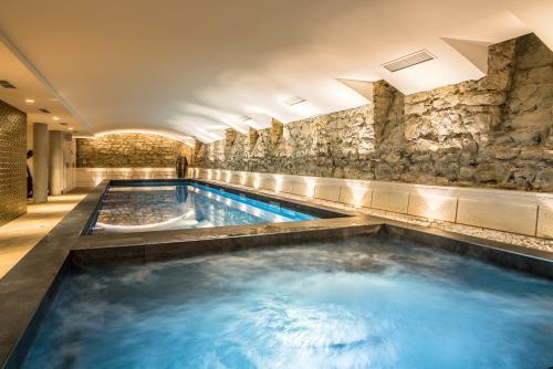The swimming pool at or near Hôtel & Spa Madison Saint Jean de Luz
