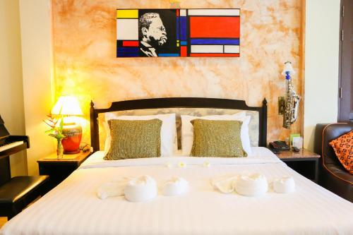 A bed or beds in a room at My Way Hua Hin Music Hotel - SHA Plus Certified -