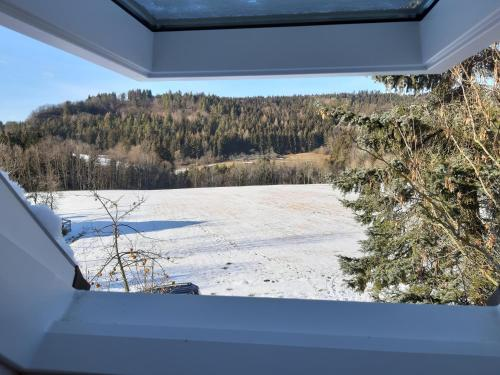 Ferienwohnung Albblick mit großer Terrasse & Garten im Winter
