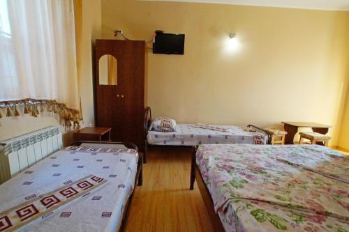 Кровать или кровати в номере Guest House Briz