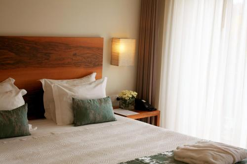 A bed or beds in a room at Convento Da Serta Hotel