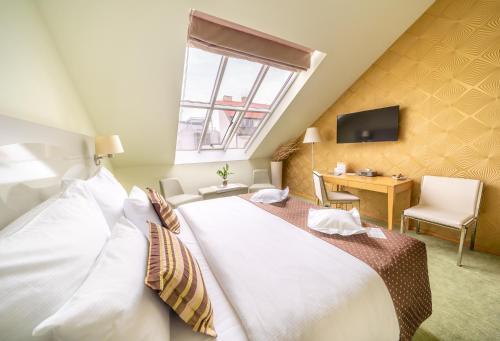 Łóżko lub łóżka w pokoju w obiekcie Grandium Hotel Prague