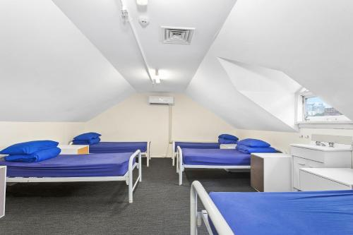 A bed or beds in a room at Summer House Kings Cross, Sydney