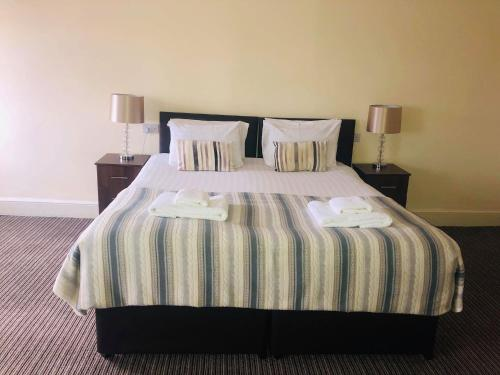 A bed or beds in a room at The New Brighton Hotel
