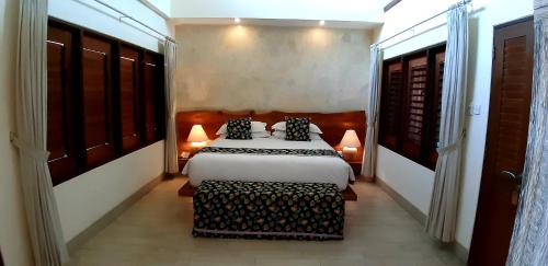 A bed or beds in a room at Bombora Medewi Wavelodge