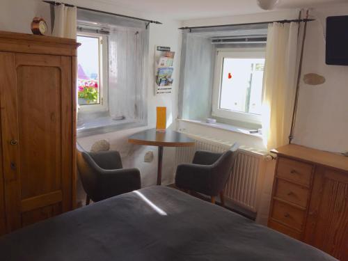 Ein Bett oder Betten in einem Zimmer der Unterkunft Burgweg Ferienwohnung