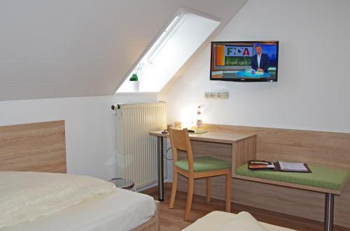 Телевизор и/или развлекательный центр в Löwenhof