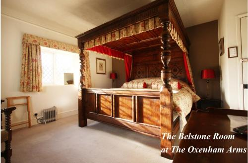 A bed or beds in a room at The Oxenham Arms Hotel Devon
