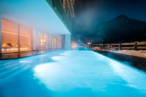 The swimming pool at or near Hotel Mareo Dolomites