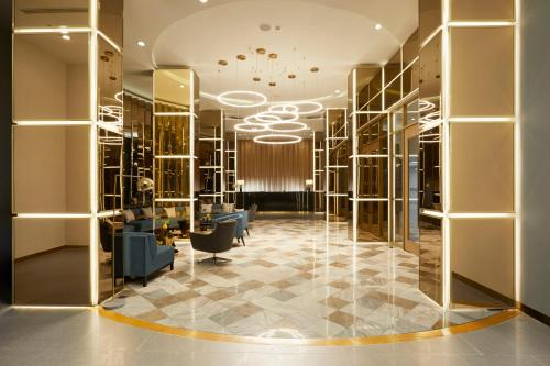 The lobby or reception area at The Quarter Ladprao by UHG