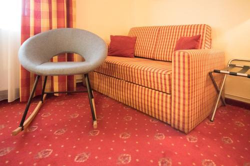 Ein Sitzbereich in der Unterkunft Wirtshaus Restaurant Pension Steirerland