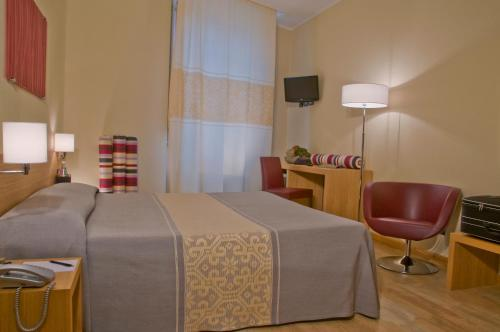 A bed or beds in a room at Hotel Italia
