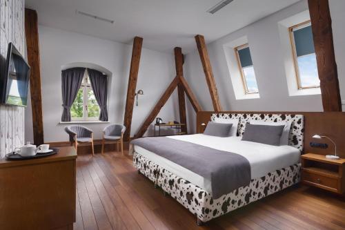 Łóżko lub łóżka w pokoju w obiekcie Relais & Châteaux Hotel Quadrille