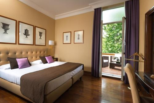 A bed or beds in a room at Hotel Imperiale