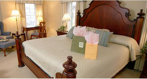 A bed or beds in a room at Lambertville House
