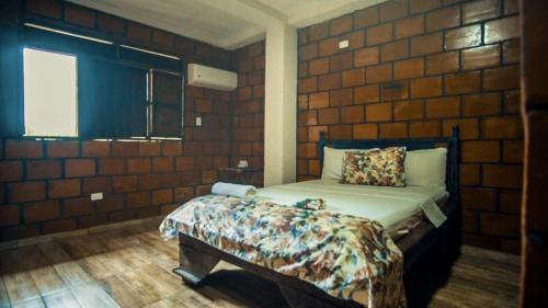 A bed or beds in a room at Hotel Acuali Nuqui